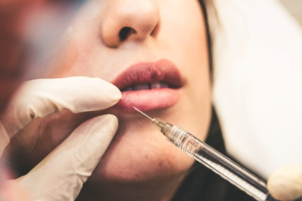 Woman being injected in the lip
